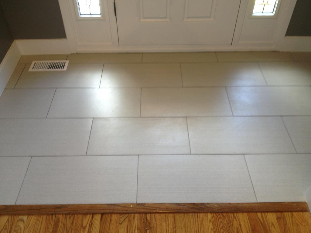 flooring replaced by front door with ceramic flooring